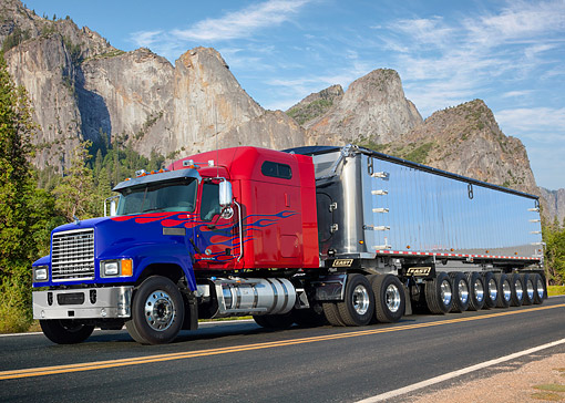 AUT 07 RK0488 01 © Kimball Stock 2012 Mack Pinnacle 613 CXU Axle Forward Red With Blue Flames