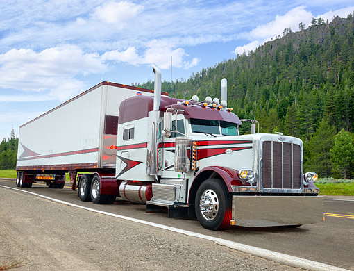 AUT 07 RK0489 01 © Kimball Stock 2012 Peterbilt 389 White And Burgundy 3/4 Front View Driving On Mountain Road