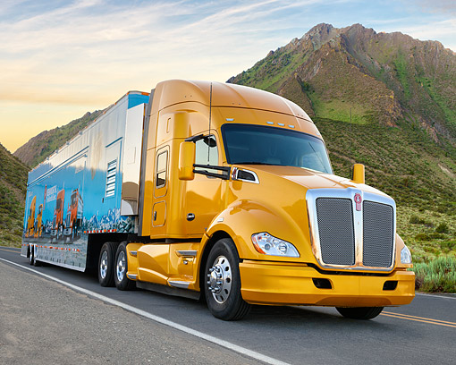 AUT 07 RK0496 01 © Kimball Stock 2014 Kenworth T680 Gold 3/4 Front View On Road By Mountain