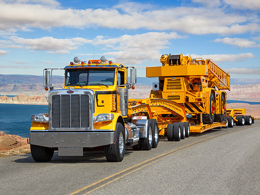 AUT 07 RK0518 01 © Kimball Stock 2014 Peterbilt 389 Towing Crane 3/4 Front View Over Road By Desert Lake