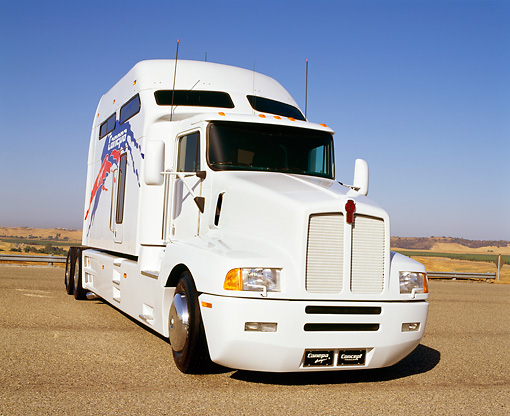 AUT 07 RK0001 02 © Kimball Stock Canepa Kenworth Semi Truck White 3/4 Front View Blue Sky