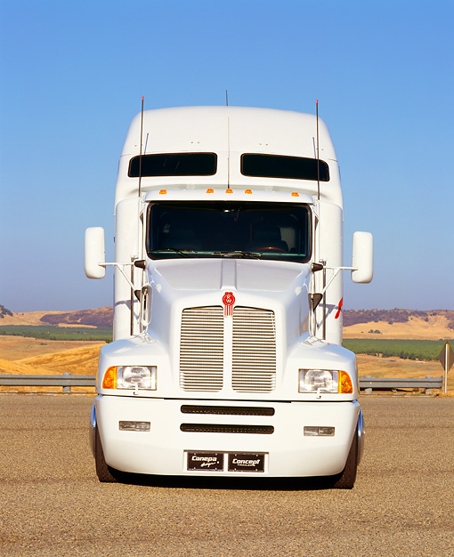 AUT 07 RK0002 01 © Kimball Stock Canepa Kenworth Semi Truck White Head On Shot On Pavement Blue Sky