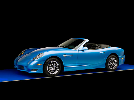 AUT 08 RK0046 01 © Kimball Stock 2006 Panoz Esperante GT Convertible Blue 3/4 Side View Studio