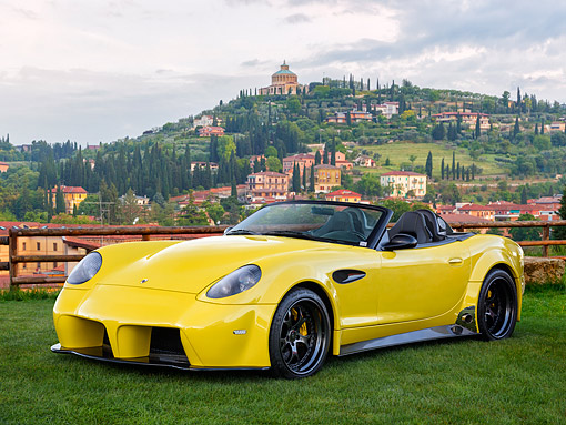 AUT 08 RK0058 01 © Kimball Stock 2015 Panoz Esperante Spyder GT Yellow 3/4 Front View By Houses And Hills