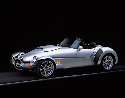 AUT 08 RK0005 04 © Kimball Stock 1999 Panoz AIV Roadster Silver 3/4 Side View On Gray Line Studio
