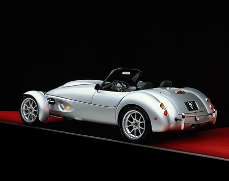 AUT 08 RK0008 07 © Kimball Stock 1999 Panoz AIV Roadster Silver 3/4 Rear View On Red Floor Gray Line Studio
