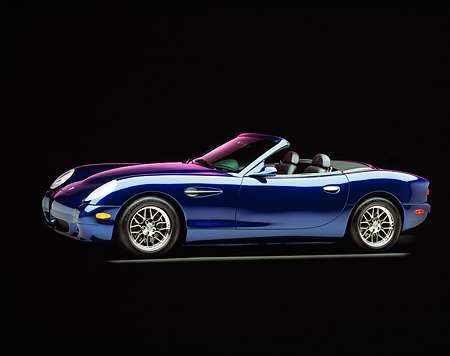 AUT 08 RK0018 04 © Kimball Stock 2000 Panoz Esperante Prototype Blue 3/4 Side View On Gray Line Purple Lighting Studio