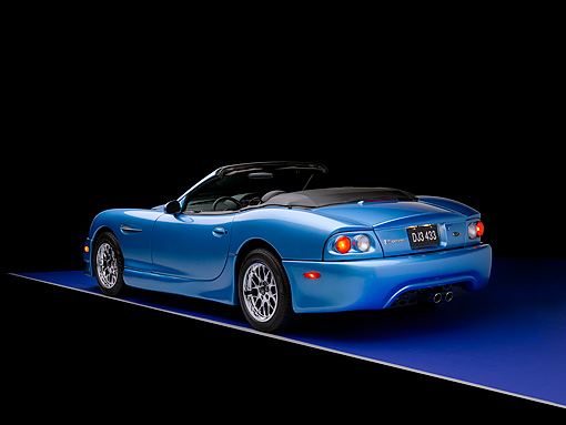 AUT 08 RK0047 02 © Kimball Stock 2006 Panoz Esperante GT Convertible Blue 3/4 Rear View Studio