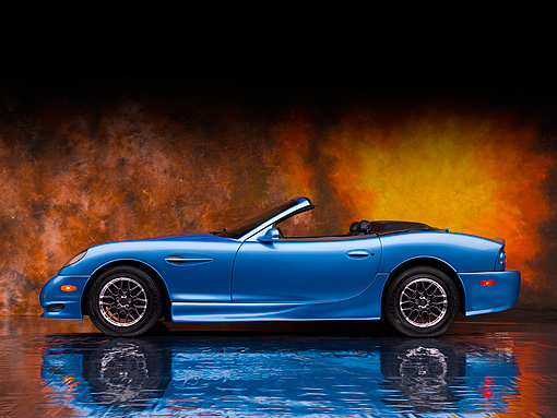 AUT 08 RK0049 01 © Kimball Stock 2006 Panoz Esperante GT Convertible Blue Profile View Sunburst Studio