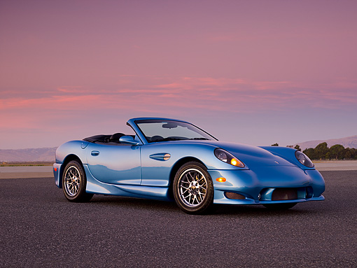 AUT 08 RK0050 01 © Kimball Stock 2006 Panoz Esperante GT Convertible Blue Low 3/4 Side View On Pavement