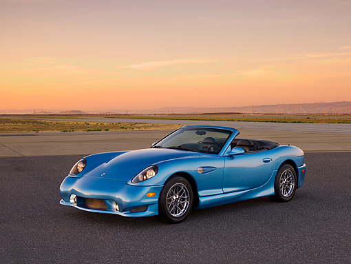 AUT 08 RK0052 01 © Kimball Stock 2006 Panoz Esperante GT Convertible Blue 3/4 Front View On Pavement