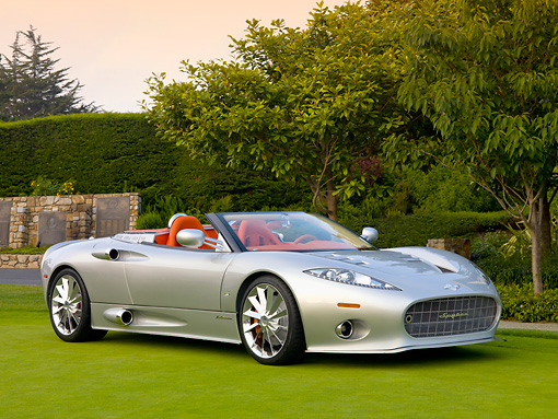 AUT 09 BK0017 01 © Kimball Stock Spyker C8 Aileron Spyder Silver 3/4 Front View On Grass By Trees