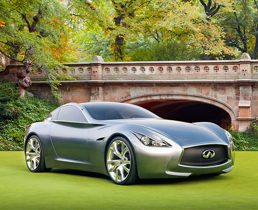 AUT 09 BK0019 01 © Kimball Stock Infiniti Essence Concept Silver 3/4 Front View On Grass By Bridge And Trees