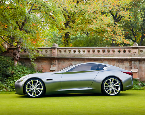 AUT 09 BK0020 01 © Kimball Stock Infiniti Essence Concept Silver Profile View On Grass By Wall And Trees