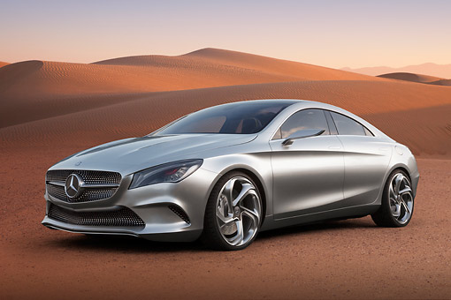 AUT 09 BK0033 01 © Kimball Stock Mercedes-Benz Coupe Concept Silver 3/4 Front View On Sand By Dunes