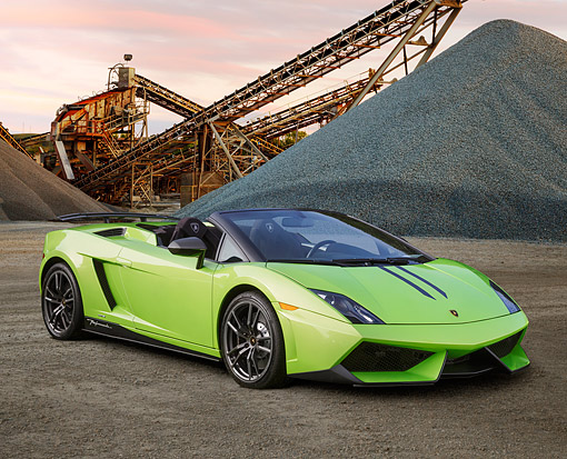 AUT 09 BK0036 01 © Kimball Stock 2013 Lamborghini Gallardo LP 570-4 Spyder Performante Edizone Tecnica Green 3/4 Front View On Gravel By Industrial Site