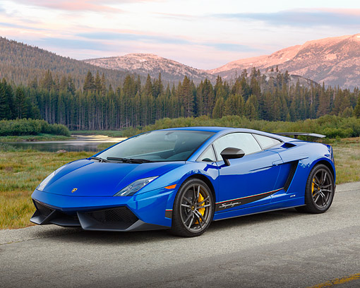 AUT 09 BK0037 01 © Kimball Stock 2013 Lamborghini Gallardo LP 570-4 Superleggera Edizione Tecnica Blue 3/4 Front View On Road By Mountains