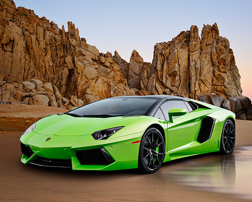 AUT 09 BK0041 01 © Kimball Stock 2014 Lamborghini Aventador LP 700-4 Green 3/4 Front View On Sand By Rocky Cliff
