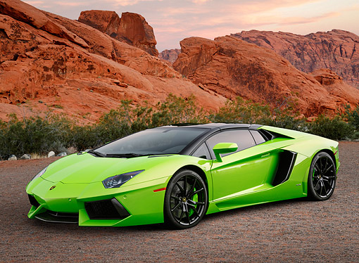 AUT 09 BK0042 01 © Kimball Stock 2014 Lamborghini Aventador LP 700-4 Green 3/4 Front View On Gravel By Red Rock
