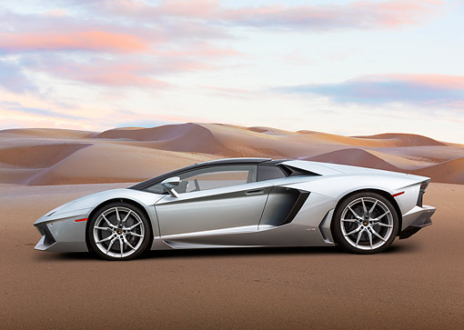 AUT 09 BK0044 01 © Kimball Stock 2014 Lamborghini Aventador LP 700-4 Silver Profile View On Sand By Dunes