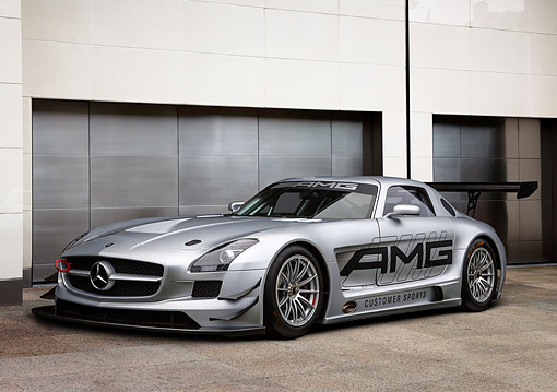 AUT 09 BK0046 01 © Kimball Stock Mercedes-Benz AMG Concept Silver 3/4 Front View On Stone By Building