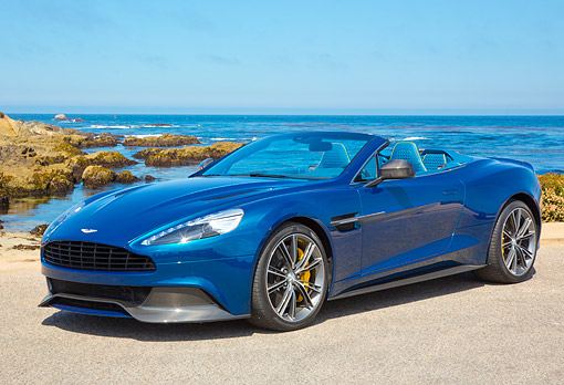 AUT 09 BK0048 01 © Kimball Stock Aston Martin Vanquish Volante Concept Blue 3/4 Front View On Beach