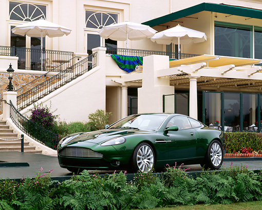 AUT 09 RK0203 01 © Kimball Stock 1998 Aston Martin Project Vantage Green Concept Car 3/4 Front View In Front Of The Lodge