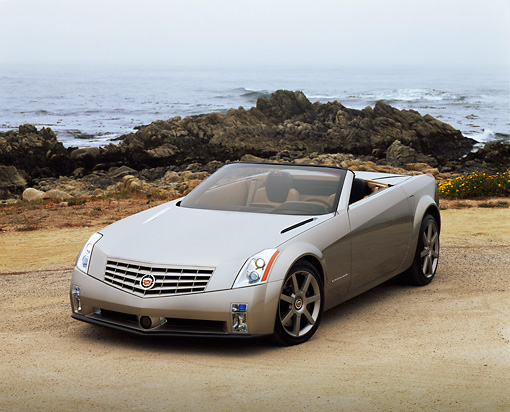 AUT 09 RK0303 03 © Kimball Stock Cadillac Evoq Convertible Silver Concept Car 3/4 Front View By Rocks And Ocean