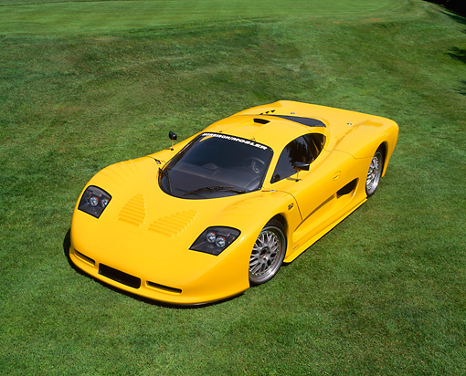 AUT 09 RK0512 06 © Kimball Stock 2002 Mosler MT900S Photon Yellow Overhead 3/4 Front View On Grass