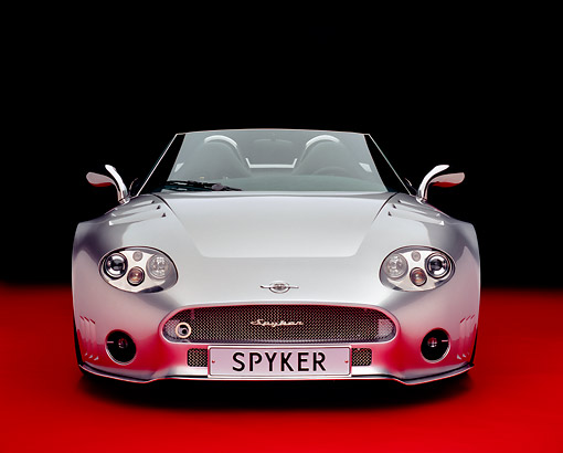 AUT 09 RK0773 08 © Kimball Stock Spyker C8 Spyder T Silver Concept Head On View Studio