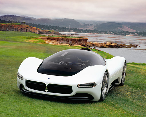 AUT 09 RK0792 05 © Kimball Stock Maserati Birdcage Pininfarina 75th Anniversary White 3/4 Front On Grass By Water