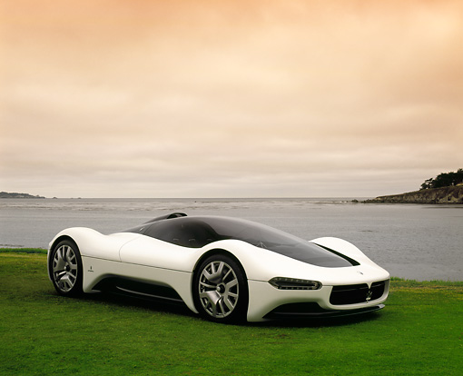 AUT 09 RK0795 02 © Kimball Stock Maserati Birdcage 75th Anniversary White 3/4 Side View On Grass By Water