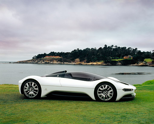 AUT 09 RK0797 04 © Kimball Stock Maserati Birdcage 75th Anniversary White Profile Shot On Grass By Water