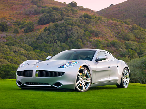 AUT 09 RK1168 01 © Kimball Stock 2010 Fisker Karma Hybrid Silver 3/4 Front View On Grass