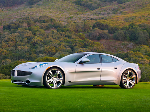 AUT 09 RK1169 01 © Kimball Stock 2010 Fisker Karma Hybrid Silver 3/4 Front View On Grass