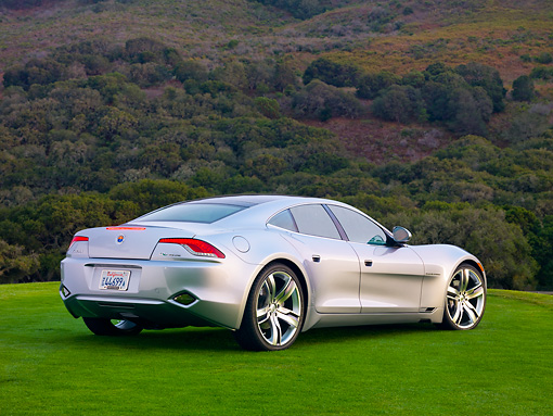 AUT 09 RK1173 01 © Kimball Stock 2010 Fisker Karma Hybrid Silver 3/4 Rear View On Grass