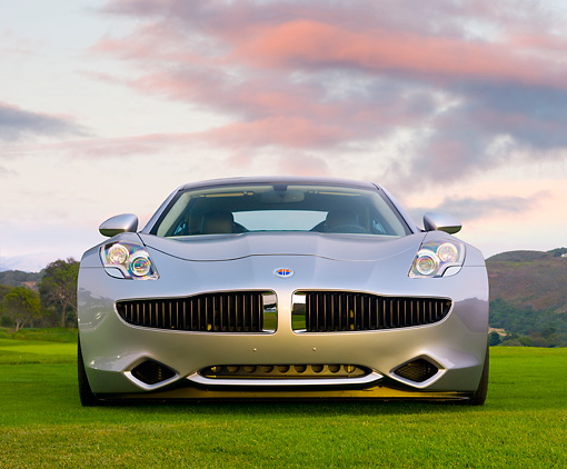 AUT 09 RK1174 01 © Kimball Stock 2010 Fisker Karma Hybrid Silver Front View On Grass