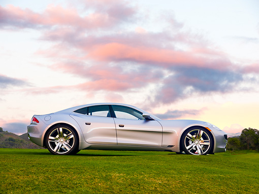 AUT 09 RK1175 01 © Kimball Stock 2010 Fisker Karma Hybrid Silver Profile View On Grass
