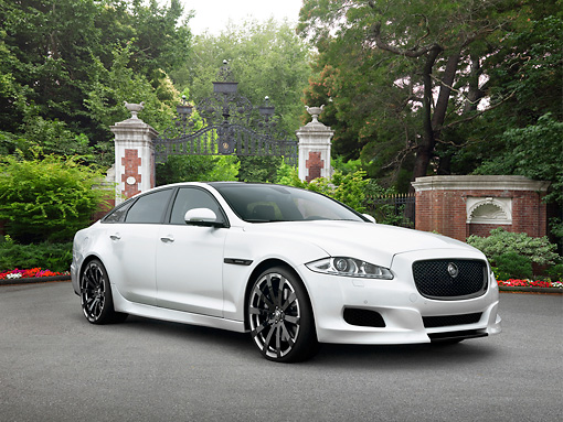 AUT 09 RK1203 01 © Kimball Stock Jaguar XJ 70 Concept White 3/4 Front View On Pavement By Trees And Gate