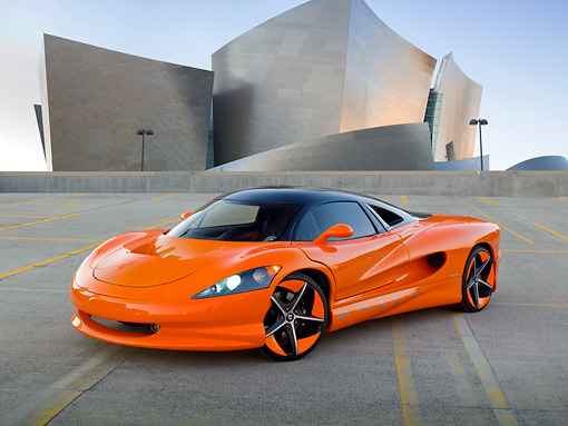 AUT 09 RK1229 01 © Kimball Stock 2011 Vision SZR Concept Orange 3/4 Front View On Roof Of Parking Garage By Building