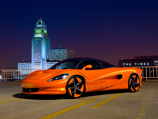 AUT 09 RK1231 01 © Kimball Stock 2011 Vision SZR Concept Orange 3/4 Front View On Pavement By Buildings At Night