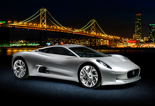 AUT 09 RK1232 01 © Kimball Stock Jaguar C-X75 Concept Silver 3/4 Front View On Pavement By Bay Bridge At Night