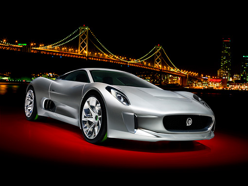 AUT 09 RK1237 01 © Kimball Stock Jaguar C-X75 Concept Silver 3/4 Front View By Bay Bridge At Night