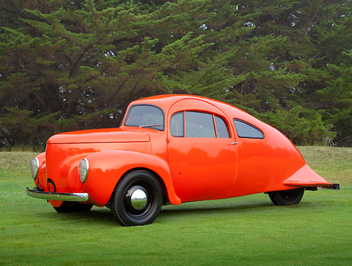 AUT 09 RK1253 01 © Kimball Stock 1937 Airomobile Orange 3/4 Side View On Grass By Trees