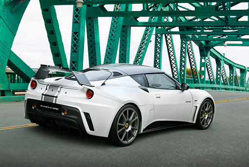 AUT 09 RK1268 01 © Kimball Stock Lotus Evora GTE Roadcar Concept Silver With Black Stripe 3/4 Rear View On Green Bridge