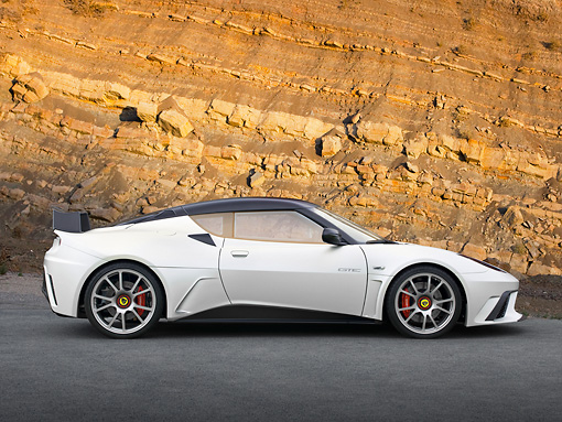 AUT 09 RK1269 01 © Kimball Stock Lotus Evora GTE Roadcar Concept Silver With Black Stripe Profile View On Pavement By Rock Wall