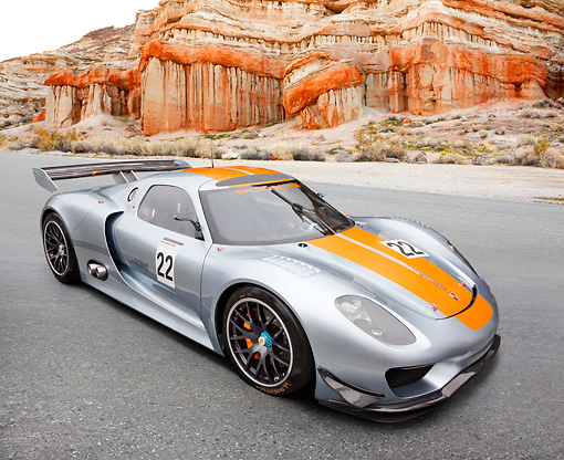 AUT 09 RK1270 01 © Kimball Stock Porsche 918 RSR Concept Silver With Orange Stripe 3/4 Front View On Pavement By Red Rock