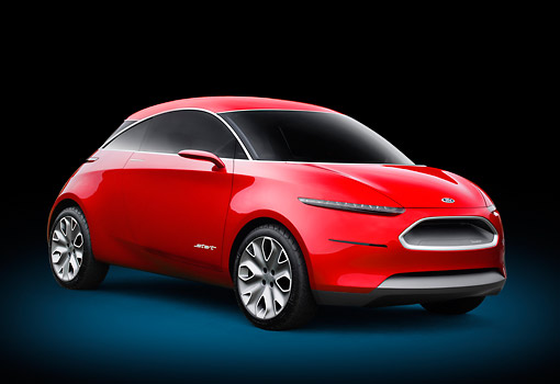 AUT 09 RK1271 01 © Kimball Stock Ford Start Concept Red 3/4 Front View On Concrete By Metal Structure
