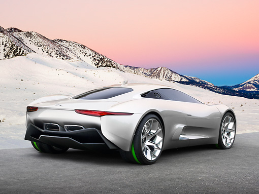 AUT 09 RK1272 01 © Kimball Stock Jaguar C-X75 Hybrid Concept Silver 3/4 Rear View On Pavement By Snow-Covered Mountains