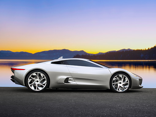 AUT 09 RK1275 01 © Kimball Stock Jaguar C-X75 Hybrid Concept Silver Profile View On Pavement By Water At Dusk